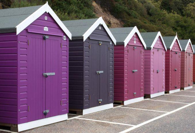 Row of purple beach huts bournemouth