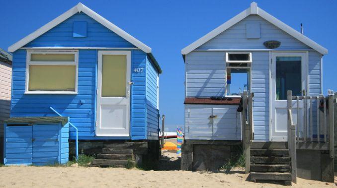 blue beach huts at mudeford sandbank
