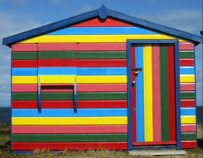 five coloured striped beach hut hopeman