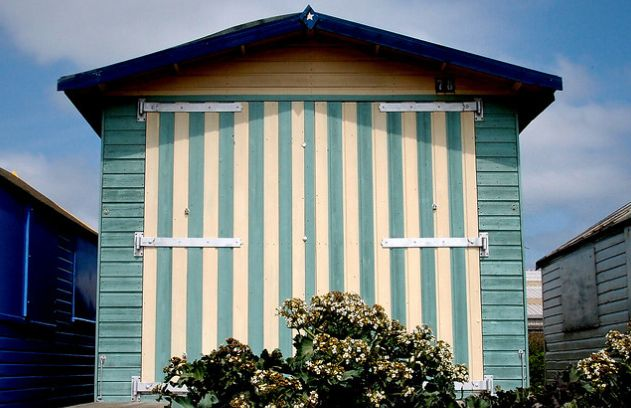 green and beige stained wood beach hut