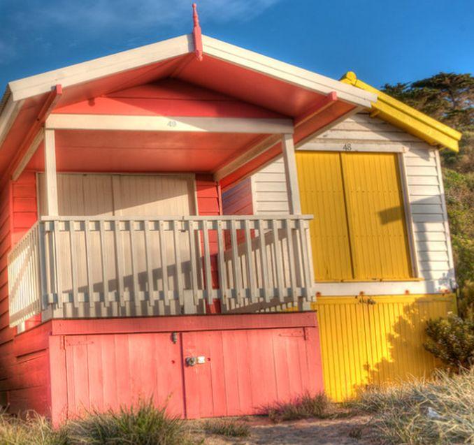 pastel pink and white beach hut with verandah