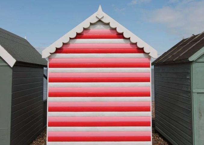 pink red white striped beach hut herne bay kent
