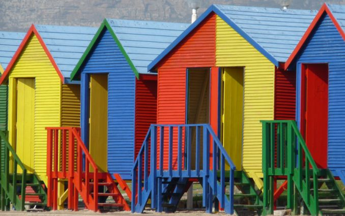 row of colouful beach huts st james cape town