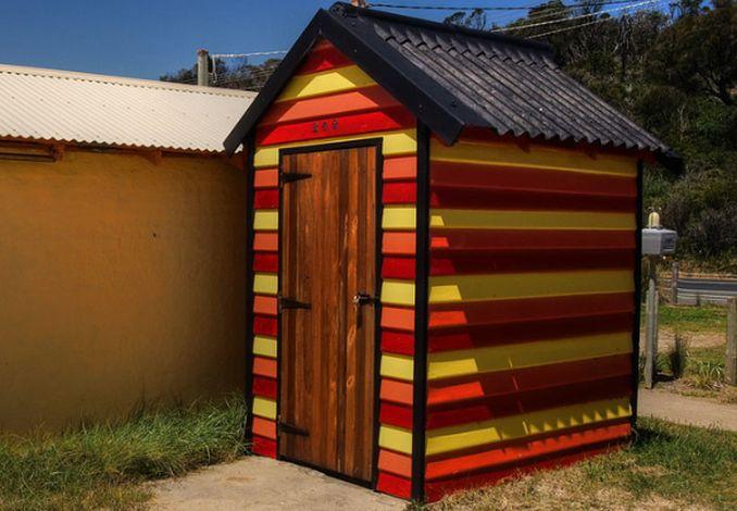 small red orange yellow beach hut rye