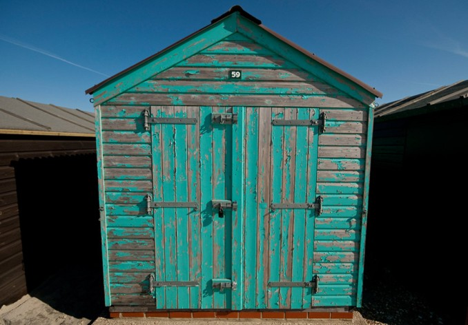 weathered aquamarine beach shed west wittering
