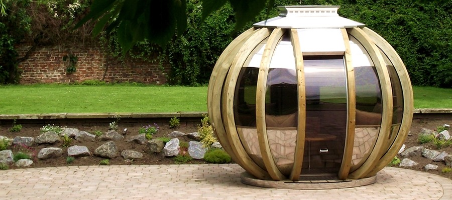 Farmers cottage deluxe summerhouse sphere on patio with door closed